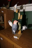 Carved wood and painted birds at feeder by Emeric Zuccaro