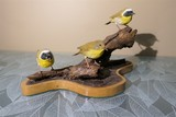 Carved wood and painted birds by Emeric Zuccaro
