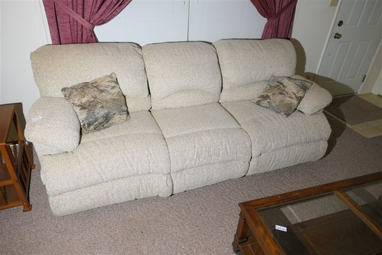 Nicer upholstered couch with pop out foot rests