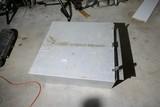 Unusual metal box and tarp contents