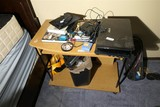 3 Laptop Computers + other items on desk