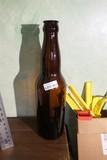 Huge oversized amber glass beer bottle