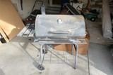 Barrel type charcoal grill