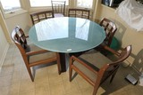 Glass topped table and 5 chairs PLUS