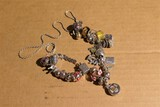 Large number sterling Pandora-style beads on chain