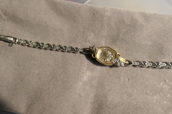 14k gold case AND band Lady's watch with diamonds