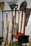 Group lot of hand tools in garage