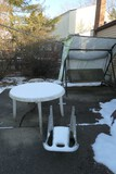 Outdoor swing with canopy, table, chairs