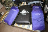 Four medium sized fight training bags, one larger