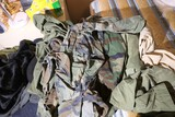 Large lot assorted military, police jackets, fatigues clothing etc.