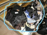 Group lot of Harley Davidson clothes on bed