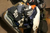 Stack of vintage clothing including t shirts