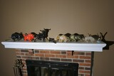 Group lot assorted decorative bulls and more on mantle