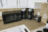 Microwave, two coffee makers, toaster lot