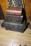 Group of three vintage style suitcases