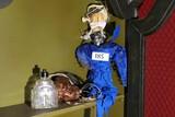 Voodoo doll, faux shrunken head, bottle