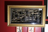 Strange framed shadowbox containing bats on branches