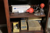 Contents of Medical cabinet, assorted syringes, tools etc