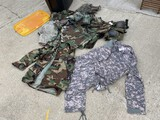 Group of assorted military camo clothing