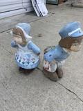 Cement Dutch Boy and Dutch Girl lawn ornaments