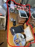 Assorted items on dresser including Samsung tablet