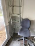 Glass shelf, office chair, lamp