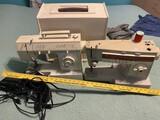 2 Older Singer Sewing Machines