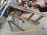 Small metal ladder, larger wooden ladder