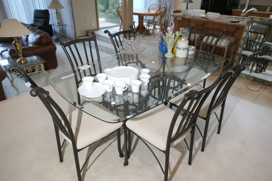 Glass topped table and set of six dining chairs