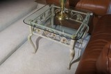 Glass topped lamp table with metal floral base