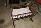 Vintage wooden rocking baby cradle