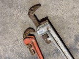 2 larger sized pipe wrenches