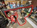 Assorted items under bench, pumps, small engines