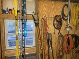 Wall lot of extension cords, levels, tools etc