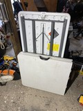 2 plastic work tables including folding
