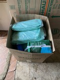 Box of adult diapers and other related supplies