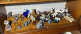 Shelf lot of carvings, figurines inc. Native Canadian made, Goebel terrier