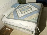 Queen sized bed with boxspring, bedspread