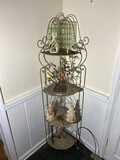 Metal stand with assorted decor pieces