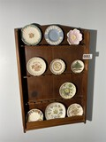 Wooden rack with small vintage plates