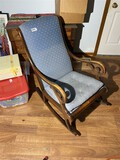 Antique upholstered rocking chair