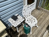 Cast metal patio or garden chair and table