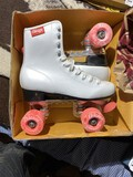Pair of size 6 girls roller skates in box