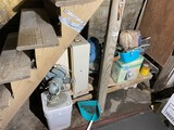 Old electric fan and items under steps