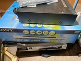 Stack of 5 DVD players in boxes