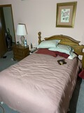 Full sized bed, picture, nightstand, lamp
