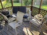 Swing bench, chairs and more in gazebo lot