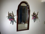 Mirror, sconces, other items on wall