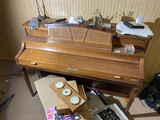 Items on and in front of piano