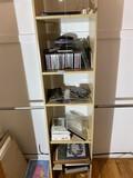Contents of shelf including CDs, frames